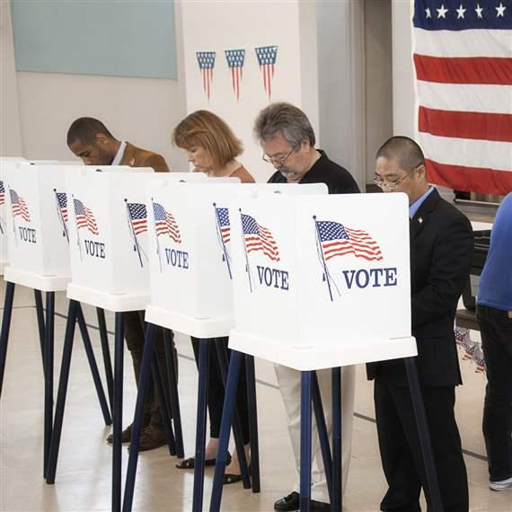 People voting in polling place jpg