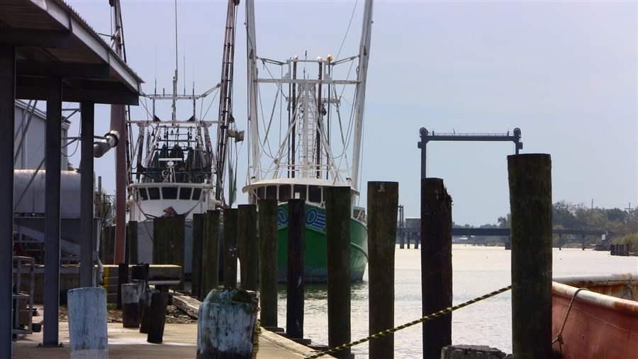 Fishing boats sit at the dock