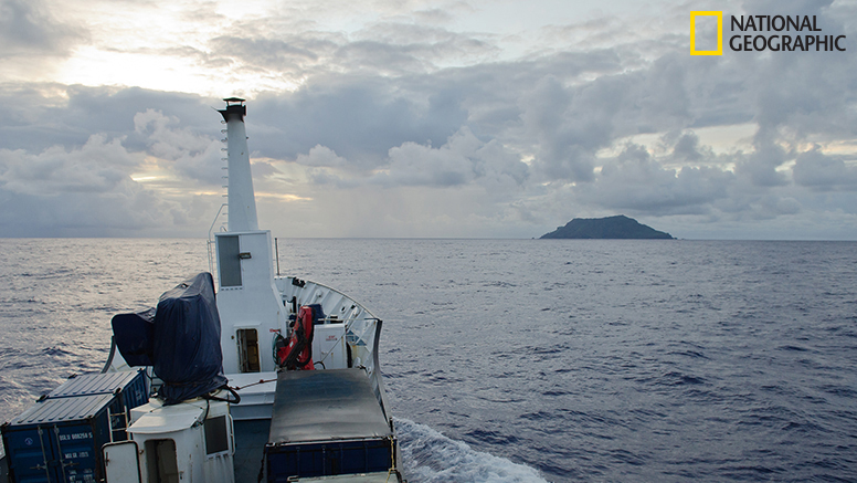 "In the early hours of morning, Pitcairn Island came into view. As Enric Sala put it, ""Surrounded by mist and rain, it resembled nothing more than a long-lost treasure island."""
