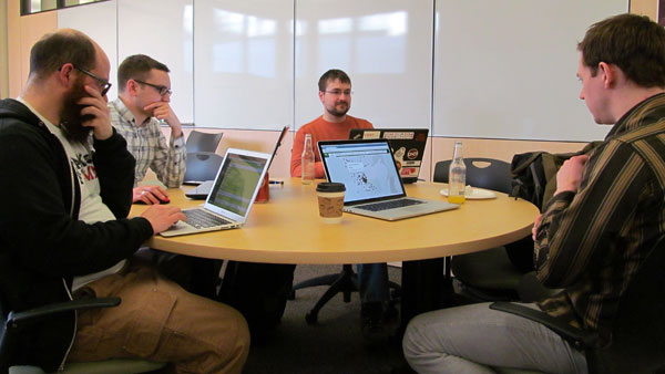 Alan Palazzolo (left), Andrew Dahl, Bill Bushey and Jake Dalton collaborate on analyzing government data at the monthly meetup of Open Twin Cities in Minneapolis.