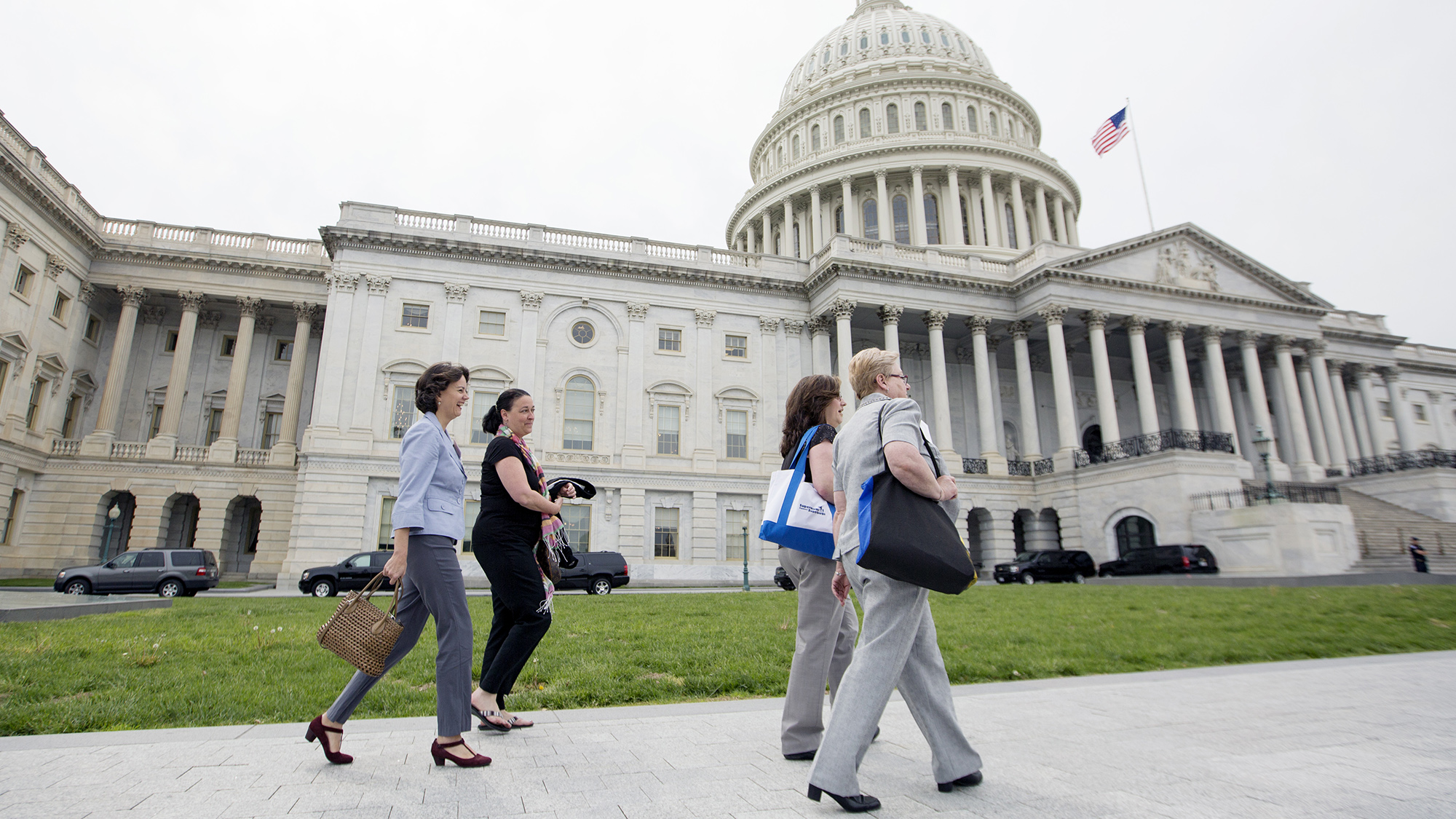 Supermoms from New York—Laura Stanley (right), Pat Assortato (left), Sarah Henris (second from left) walk to the Capitol with Pew's Laura Rogers.