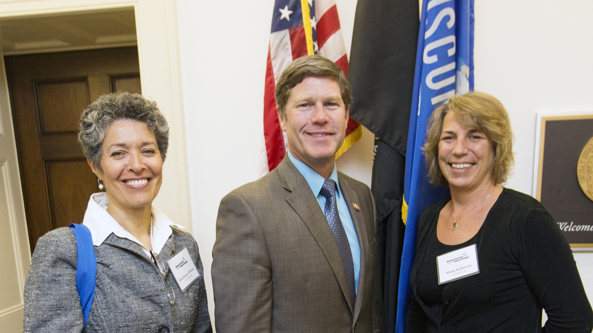 Sylvia Burgos Toftness (left) and Mary Anderson, both sustainable farmers in Wisconsin who use antibiotics only to treat sick livestock, meet with Representative Ron Kind (D-WI).