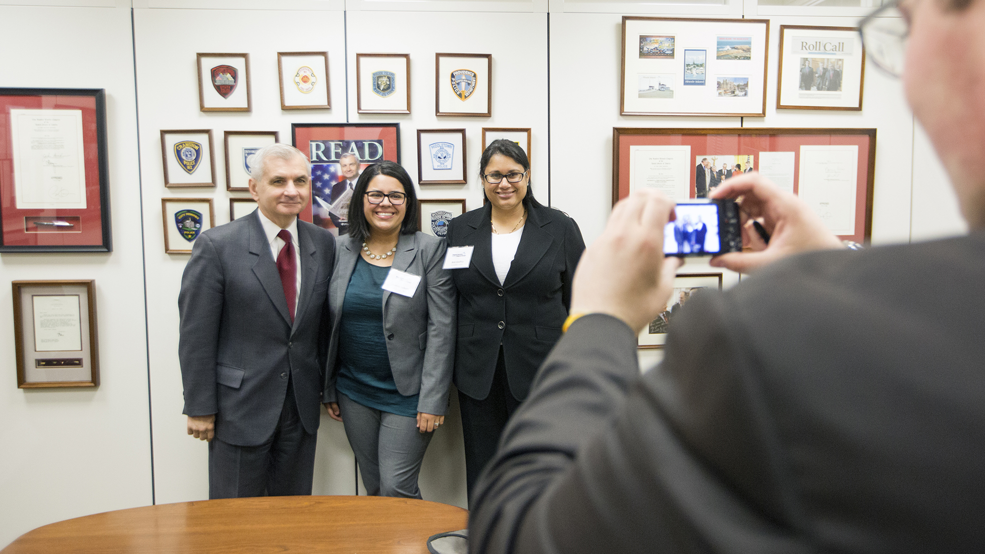 Supermom Shanna Lubold (center) and Ami Gadhia of the March of Dimes pose with Senator Jack Reed (D-RI). Lubold's son, Samuel, was born prematurely, and during his 14-week stay in the neonatal intensive care unit, he developed a staphylococcal infection, putting his already weak lungs in peril. With the help of antibiotics, he overcame his illness and is now a smart, healthy, and funny 3-year-old.