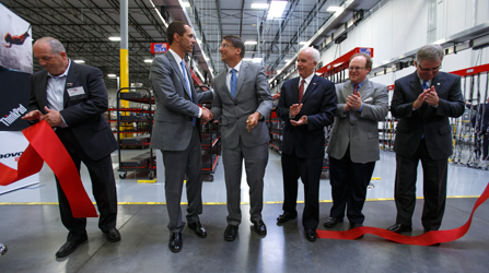North Carolina Gov. Pat McCrory, center, and Lenovo President for North America Jay Parker celebrate the company's opening of a ThinkPad production facility in Whitsett, N.C. last month. Apple and Motorola Mobility also are opening U.S. plants (AP)