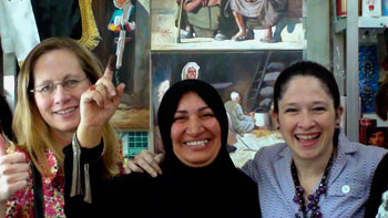 North Dakota state Rep. Bette Grande (left) and Illinois state Rep. Susana Mendoza (right) were with a group of state lawmakers who helped monitor Iraq's elections earlier this month. Here, they pose with an Iraqi woman whose finger is purple, indicating she had voted.