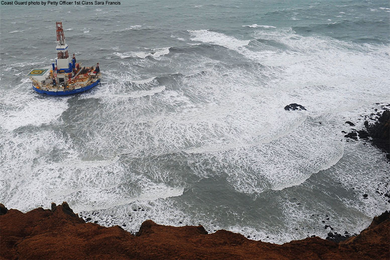Drilling ship Kulluk sits aground on the southeast shore of Sitkalidak Island about 40 miles southwest of Kodiak City, Alaska, in 40 mph winds and 20-foot seas Tuesday, Jan. 1, 2013.