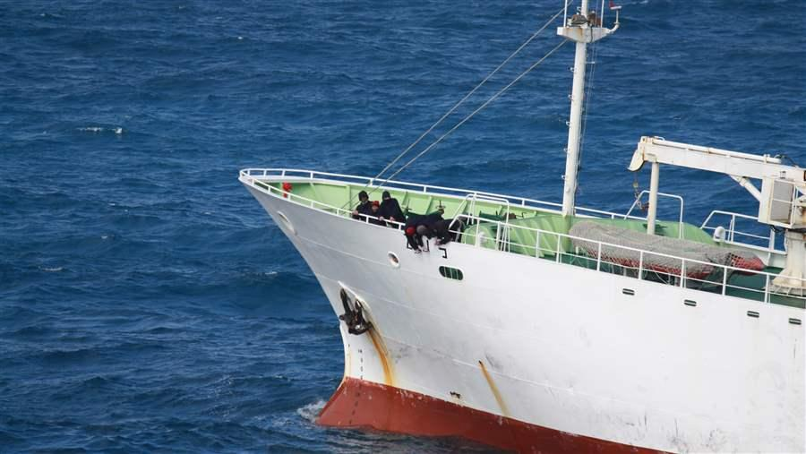 Crew of illegal fishing vessel paint a new name on the hull