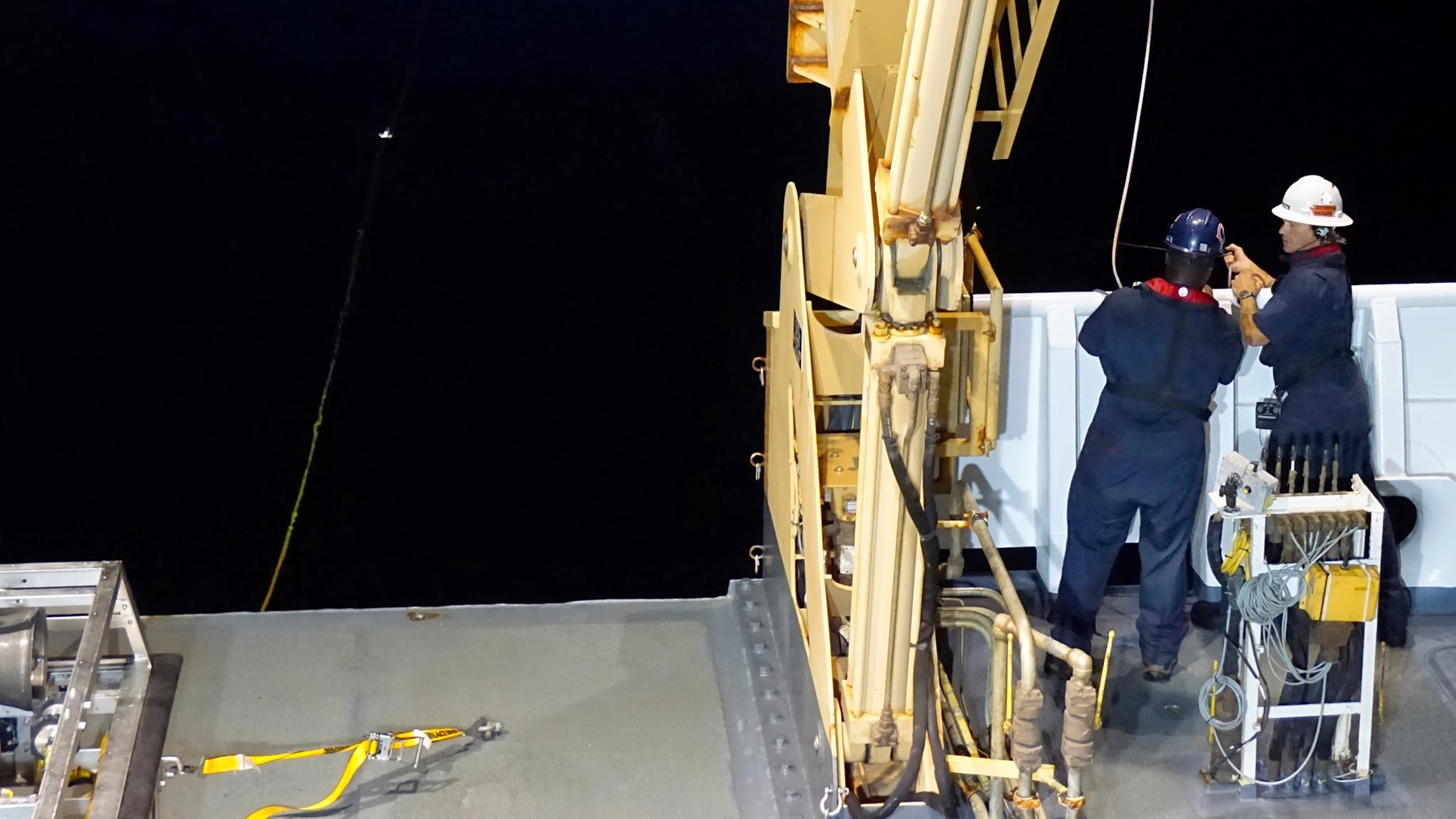 Crew members, hauling Deep Discoverer back on board, work long hours every day.