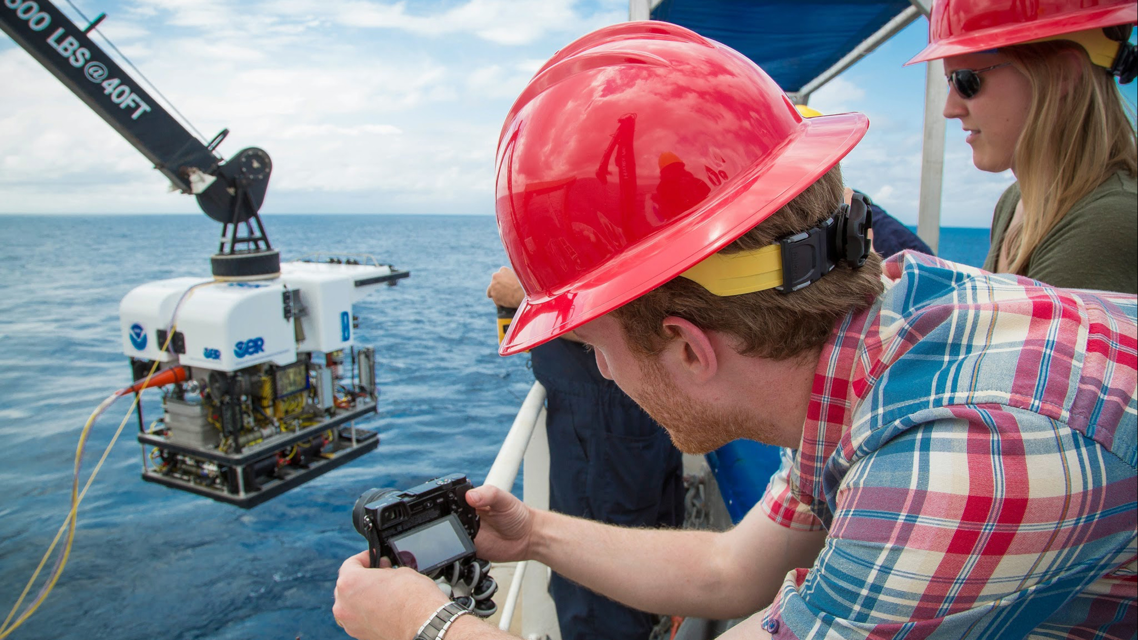 The ship's remotely operated vehicle, the 9,200-pound Deep Discoverer, is carefully lowered into the water.