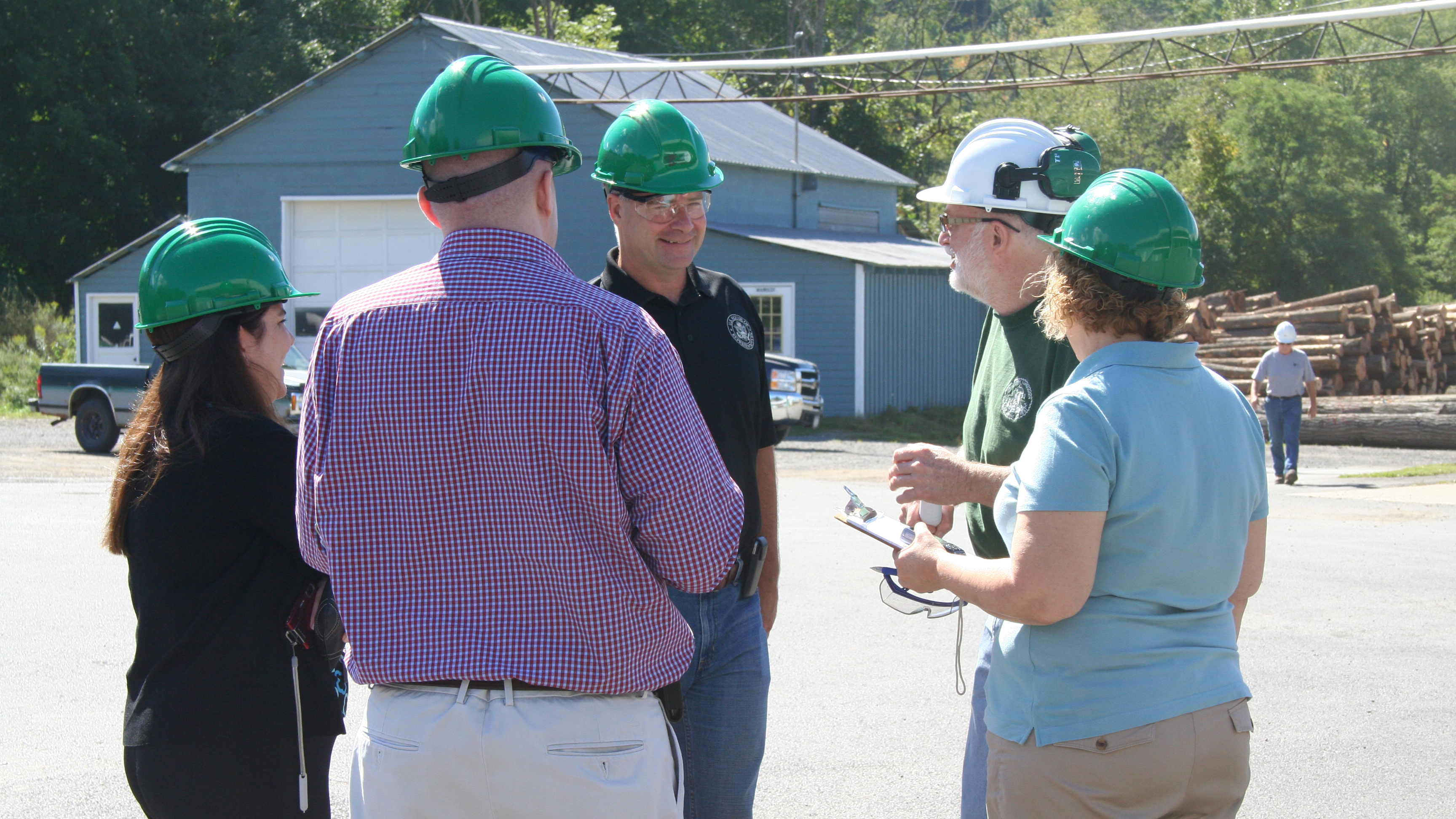 Rep. Chris Gibson of New York (R, 19th District), lead co-sponsor of the POWER Act, joins Pew's Jessica Lubetsky on a tour of a waste heat to power project at Wightman Lumber in Portlandville, New York (Aug. 29, 2014).