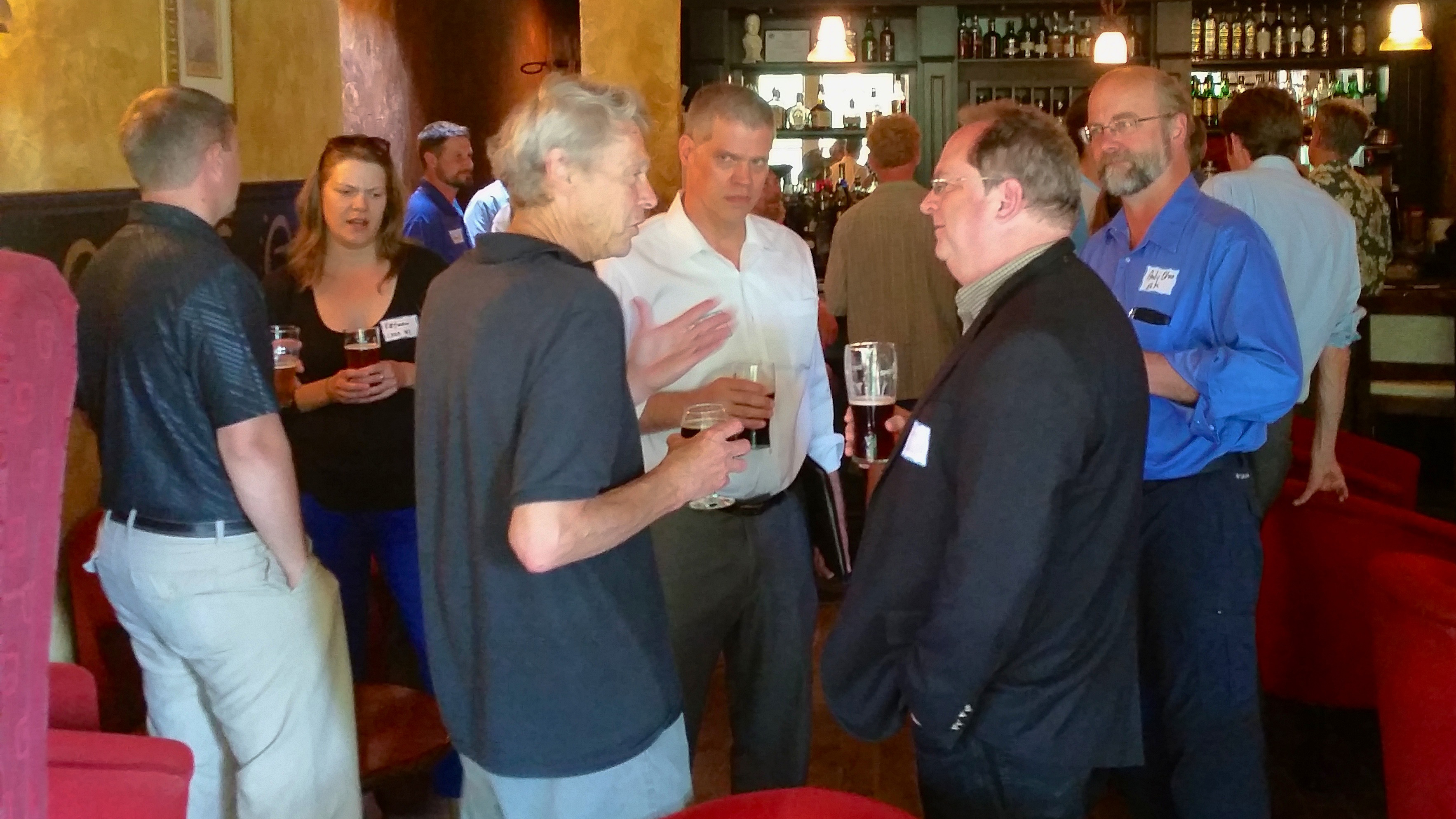 CEBN members network after a policy briefing in Madison, Wisconsin (July 10, 2014).
