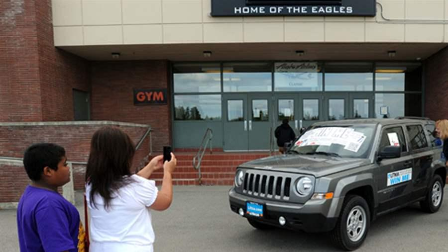Students look at Jeep Patriot