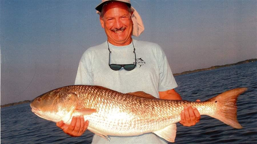 Mitch Roffer with a jumbo red drum, also known as a bull redfish, caught in the Indian River Lagoon (IRL) in east Central Florida. The IRL complex—which includes the Banana River Lagoon, several rivers and the Mosquito Lagoon—is a popular red drum fishing destination. Adult red drum rely on forage fish for the energy and nutrients necessary to grow and reproduce.