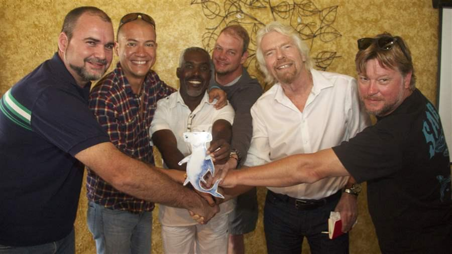 Sir Richard Branson (second from right) and friends celebrate shark conservation with Shark Stanley in Bimini, The Bahamas