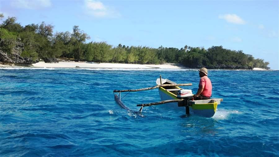 Local fisherman in a traditional canoe off Rimatara.