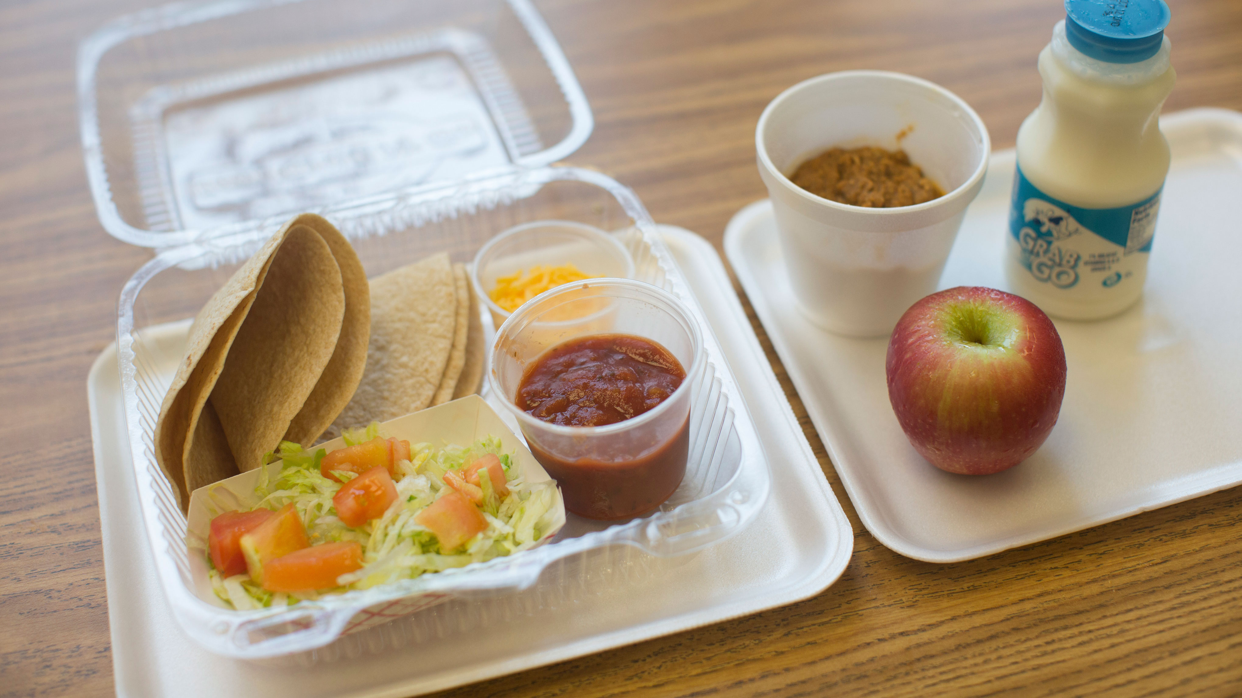 Cafeteria staff prepare school lunches for students