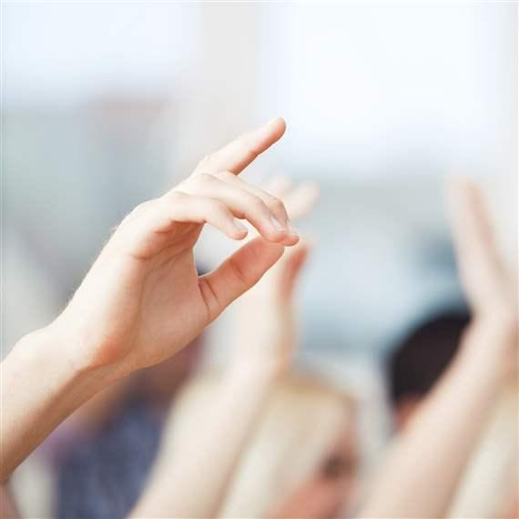 classroom students raising hands