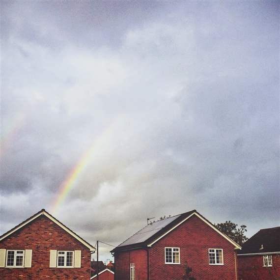 House with rainbow over it
