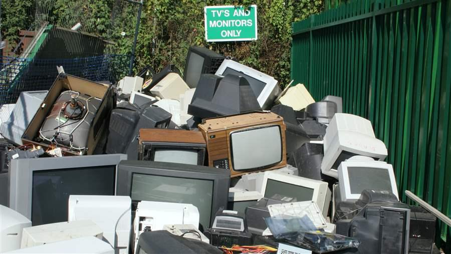 TV and desktop computer monitors await recycling
