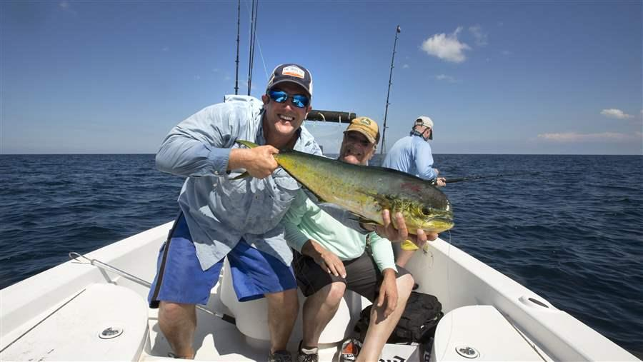 Fishermen show off their catch of mahi-mahi off Southeast Florida.