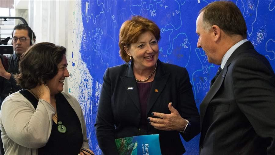 Pew's Bronwen Golder, Minister for Conservation Maggie Berry, and Prime Minister John Key