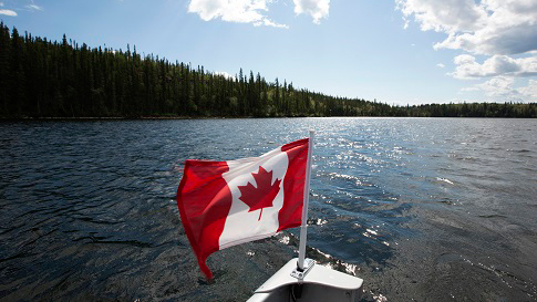 Canadian flag on a boat.