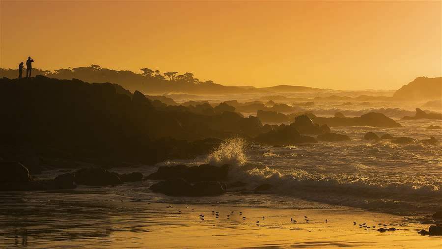 The sunset over Pebble Beach, California