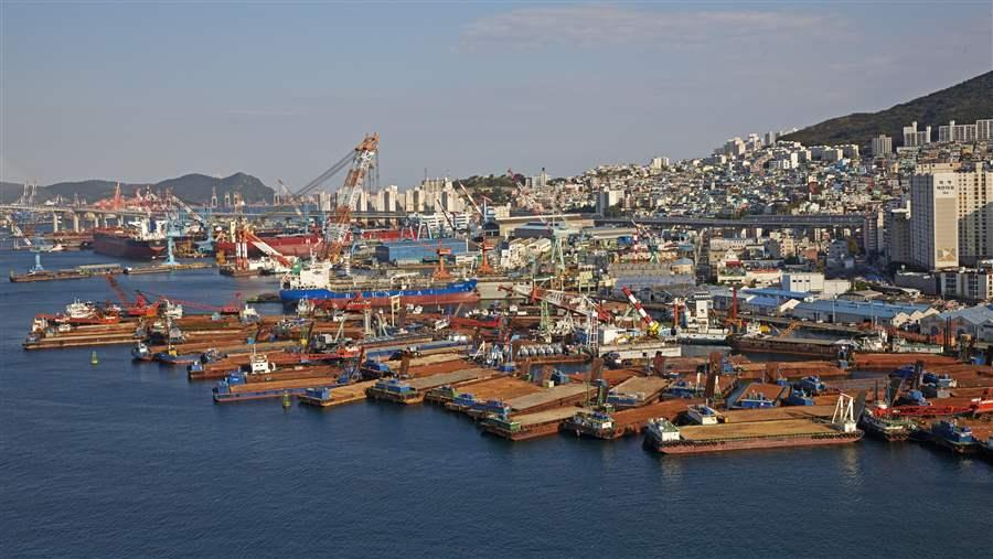 Elevated cityscape of industrial harbour in Busan.