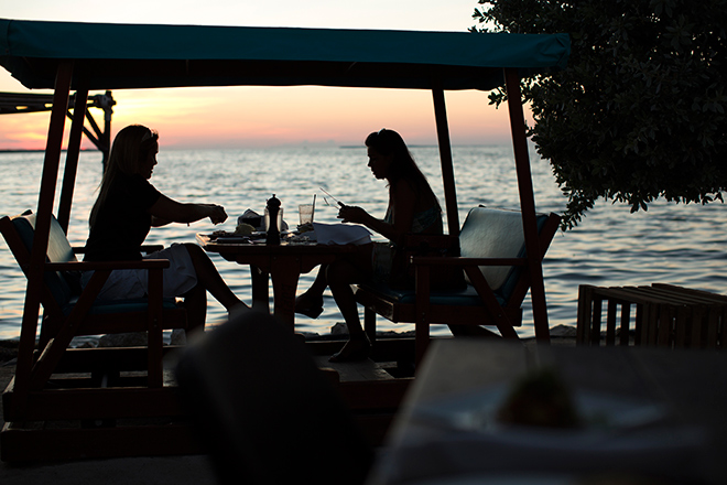 People eating by the Caribbean Ocean