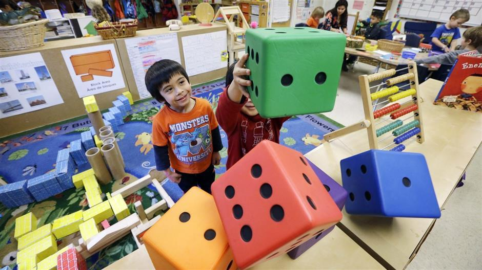Preschoolers at the Creative Kids Learning Center in Seattle. A growing number of cities and states are imposing academic standards and other rules on child care providers and using public money to expand access to them.