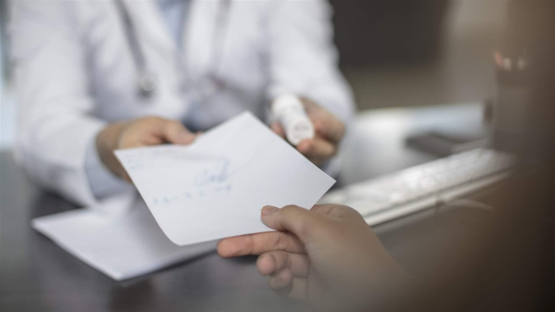 Doctor giving patient a note