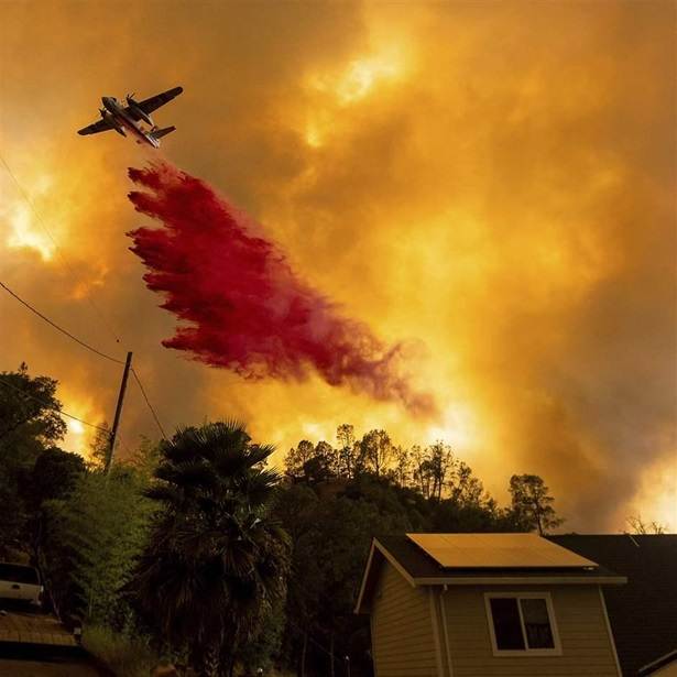 Air tanker fighting fire