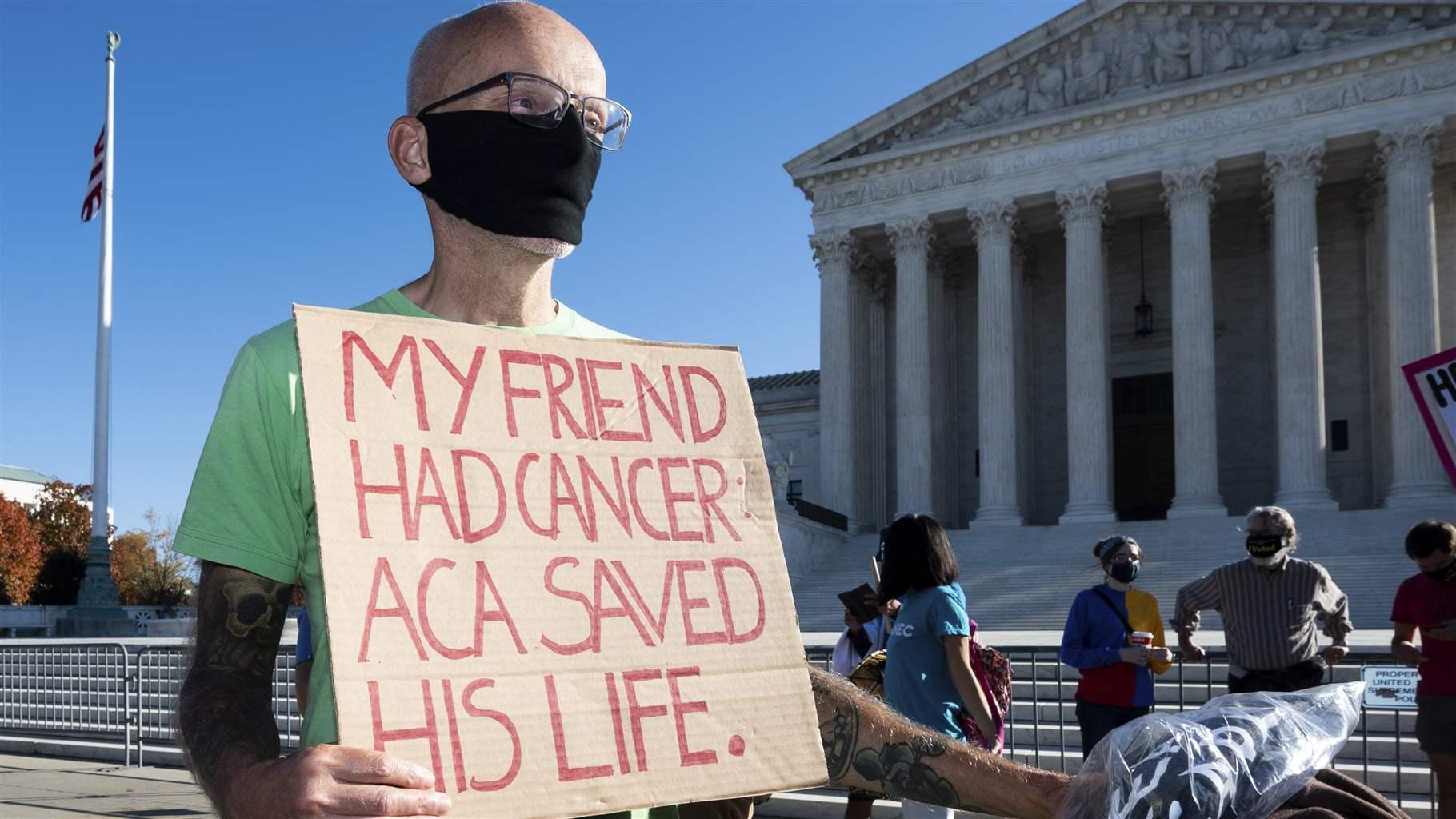 ACA supporter with sign