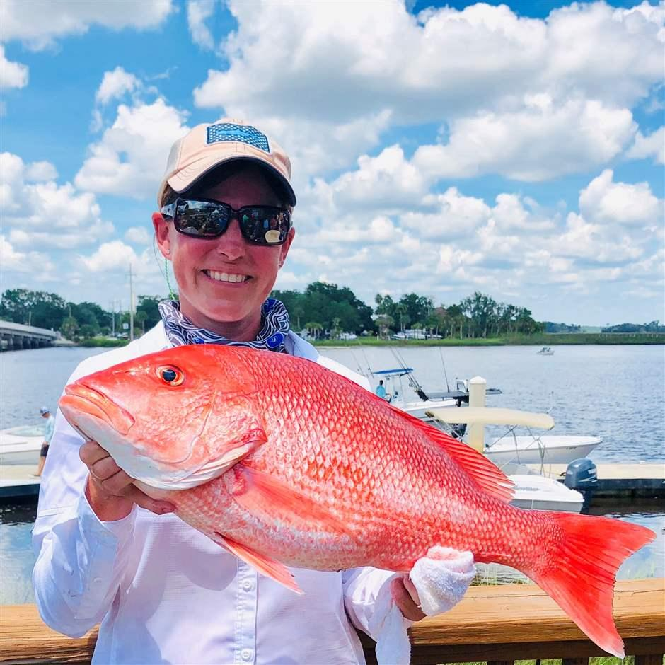 Kellie Ralston holds a red snapper