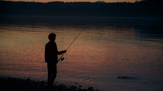 man fishing at Puget Sound