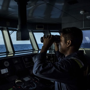 A security ship crew of Ministry of Maritime Affairs and Fisheries observes during a patrol in the South China Sea on August 17, 2016 in Natuna, Ranai, Indonesia.