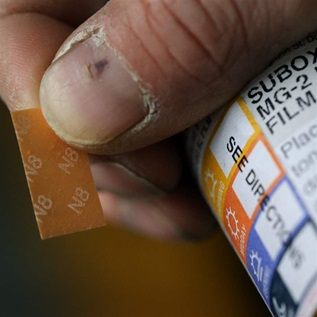 A patient displays his Suboxone prescription following his appointment at the Substance Use Disorders Bridge Clinic at Massachusetts General Hospital in Boston on April 27, 2018. The patient takes Suboxone, a medicine that contains buprenorphine and naloxone, to treat his substance use disorder. He said he had been addicted to Opioids for 10 years but has been drug free since he started taking Suboxone nearly 2 years ago.