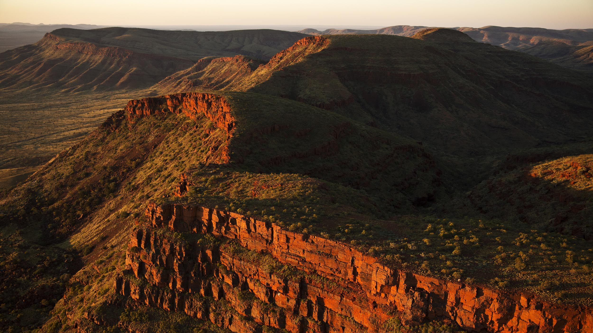 A typical Pilbara landscape of mesas, escarpments, rolling hills and spinifex grasslands at Mount Frederick, Western Australia.