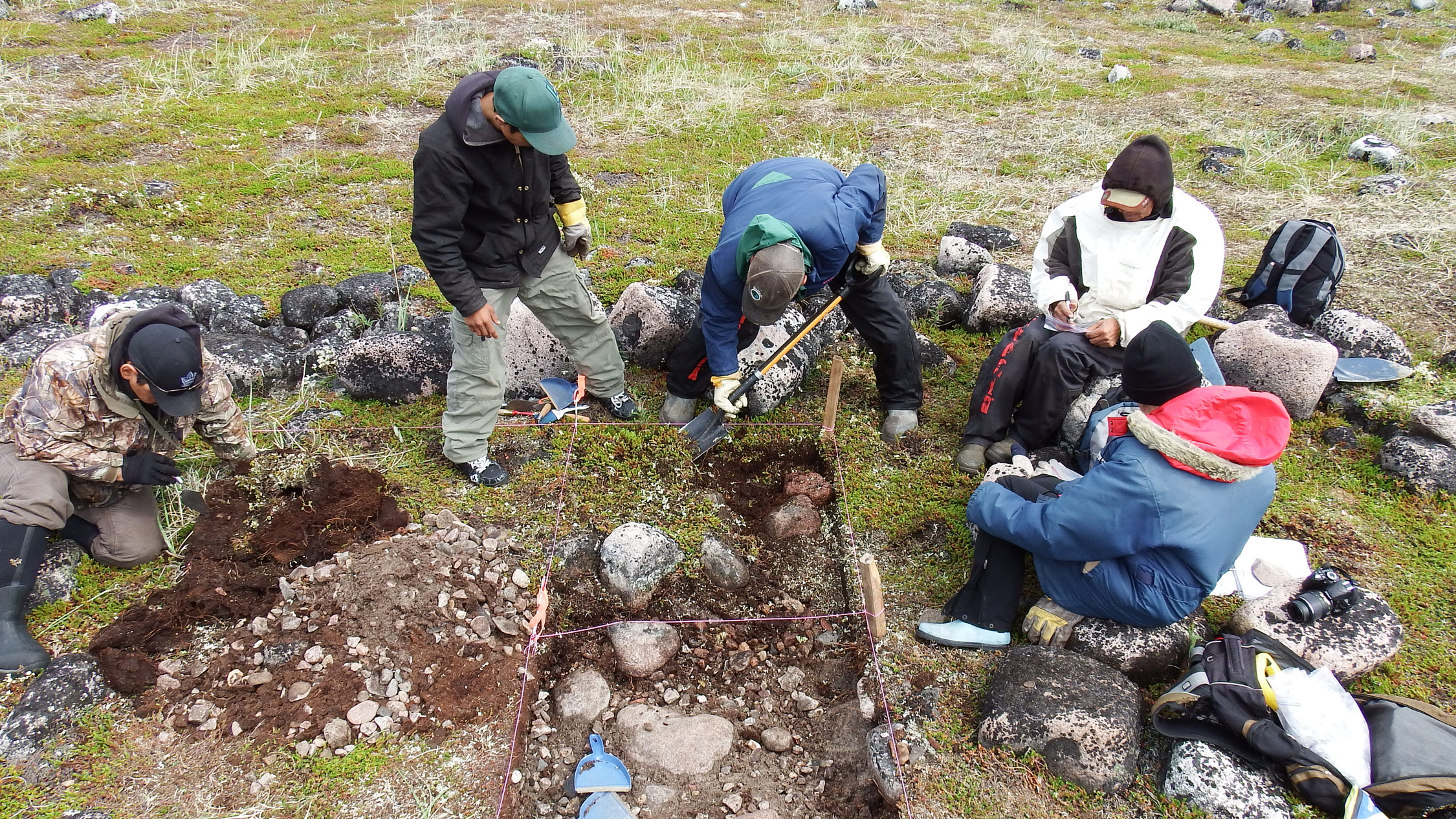 Excavating a multifamily longhouse, from left: Johnny Mamgark, David Tassiuk, Peter Alareak, Luke Suluk, and Virginia Petch.