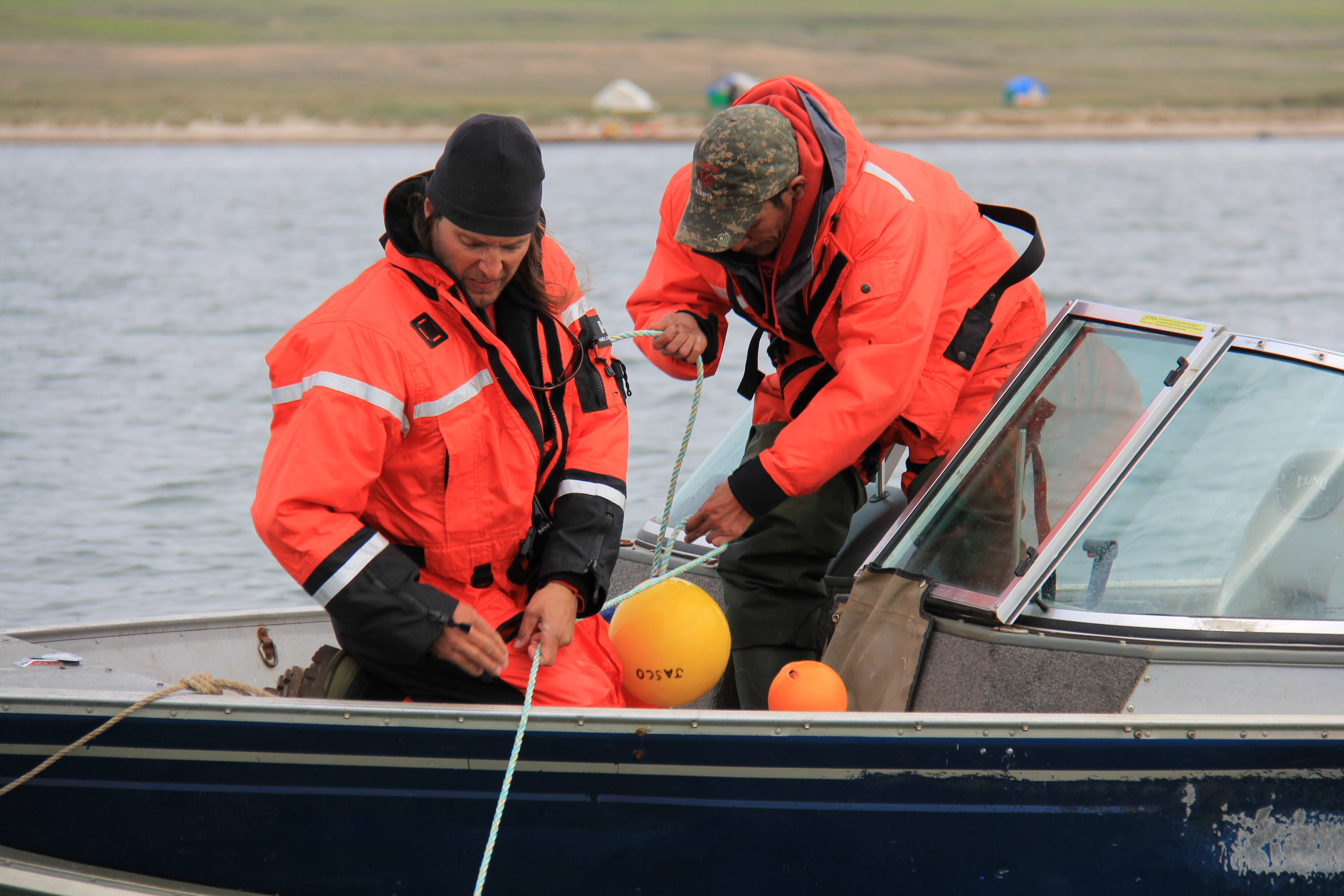 Technicians deploy a hydrophone in Darnley Bay.