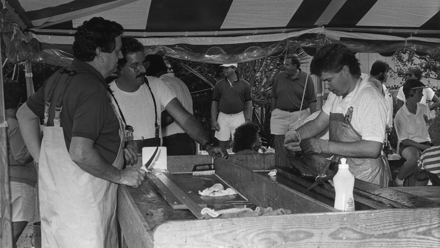 While serving as director of North Carolina's fish policy in the 1980s, Hogarth (left) spends a day inspecting fish that are collected for study.