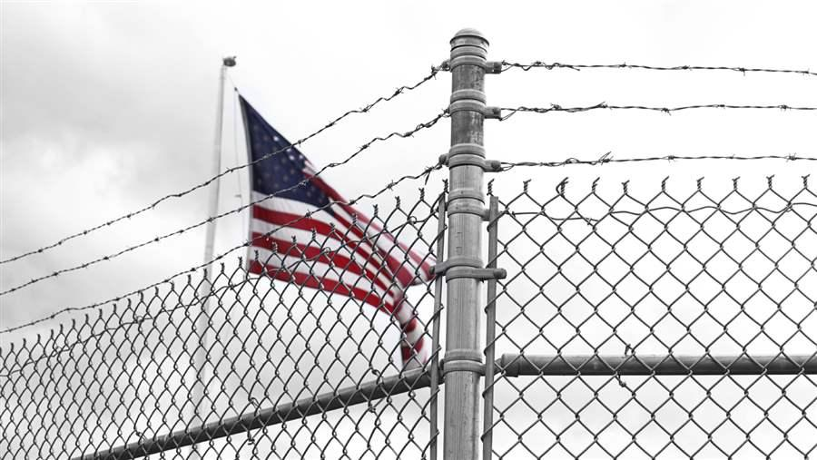Flag behind a fence