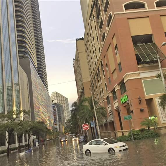 Flooded street with vehicle