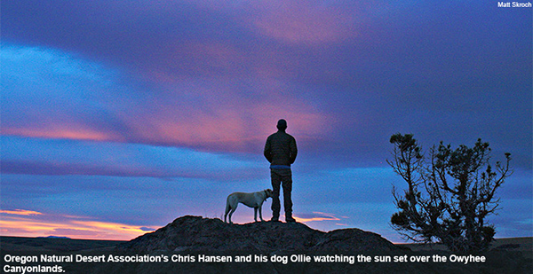 Oregon Natural Desert Association's Chris Hansen and his dog Ollie watching the sun set over the Owyhee Canyonlands.