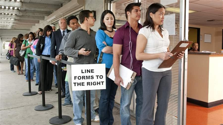 People standing in line to register to vote