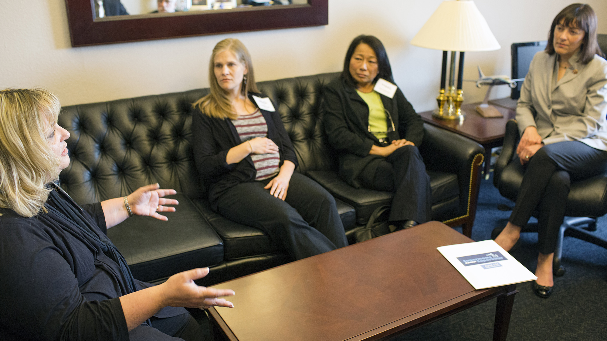 Cheryl Perron (left), whose son lost his leg and nearly his life due to an antibiotic-resistant infection, talks about the need for stronger regulation to end the overuse of antibiotics in agriculture with Representative Suzan DelBene (D-WA) (right). With Perron are Bethany Cook (center left), a registered dietitian, and Eiko Vojkovich, an organic farmer.