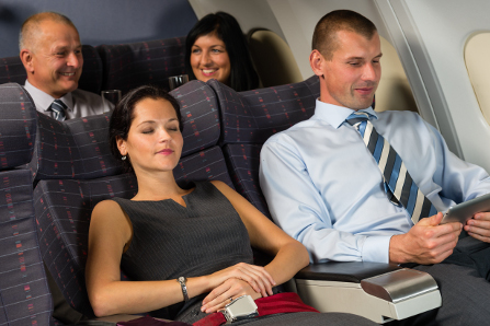 Business travelers relax on a flight.