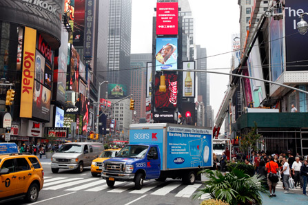 A delivery truck makes its way through New York's Times Square in October 2012.
