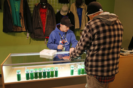 A customer surveys the options at a Denver-based marijuana dispensary that plans to begin selling the drug to recreational users.
