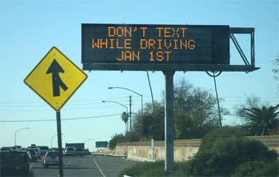 An electronic billboard on California's 5 freeway reminds drivers that as of Jan. 1, they cannot send text messages while driving.